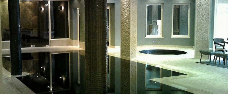 Bisazza mosaic tiled steam room with matching infinity pool